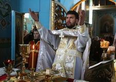 Orthodox. VOYUTYN, UKRAINE - JANUARY 08 - Priest consecrates bread during orthodox liturgy ceremony in Voyutyn on January 08, 2009 stock photo