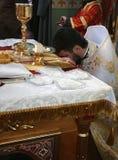 Orthodox. VOYUTYN, UKRAINE - JANUARY 08 - Priest consecrates bread during orthodox liturgy ceremony in Voyutyn on January 08, 2009 royalty free stock photography