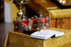 Orthodox wedding accessories. Including two crown and Holy Bible stock images