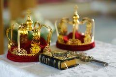Orthodox wedding crowns, gospel and cross Stock Photos