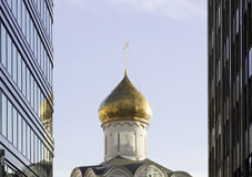 Orthodoxy church between skyscrapers in Moscow Royalty Free Stock Photos