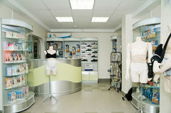 Orthopaedic pharmacy. Interior of a modern orthopaedic pharmacy with different goods stock image