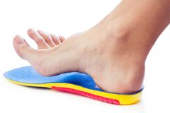 Orthopedic insole and female leg. Above it Stock Photo