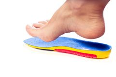 Orthopedic insole and female leg. Above it royalty free stock photos