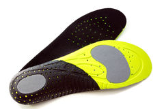 Orthopedic insoles for athletic shoes. On white background Royalty Free Stock Images