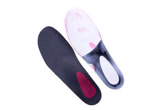 Orthopedic insoles on white background. Orthotics on a white background. Insert in shoes to support the foot royalty free stock photo