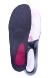Orthopedic insoles on white background. Orthotics on a white background. Insert in shoes to support the foot royalty free stock photos