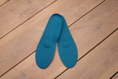 Orthopedic insoles on wooden boards. Insoles for flatfoot. insoles close up. medical insoles. orthopedic purpose insoles. insoles for problem feet stock photo