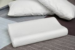 Orthopedic pillow on bed. Physiotherapy concept royalty free stock photography