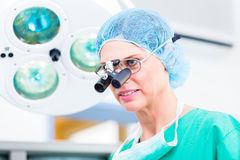 Orthopedic surgeon with special glasses Royalty Free Stock Photo