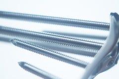 Orthopedic surgery plate & screw implant Stock Photos