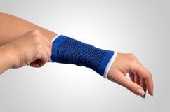 Orthopedic wrist brace. Hand with a orthopedic wrist brace Stock Photos