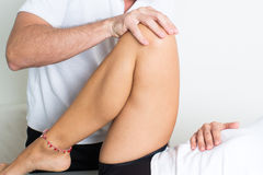 Orthopedics. Orthodontists treats leg of a woman Stock Image