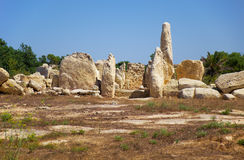 The orthostats forming the entrance to the Northen temple of Hag. The big orthostats forming entrance to the oldest part of megalithic temple of Hagar Qim, the Royalty Free Stock Image