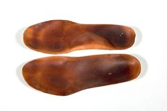 Orthotics. Leather orthotics for insoles in shoes or sneakers Stock Images