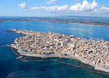 Ortigia from the sky. A panoramic view of ortigia island (Siracusa-Siciliy) taken from a light plane. You can see the harbor and the Maniace castle