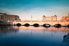 Ortigia, Syracuse, Italy / December 2018: View of the strait of water between mainland Siracusa and Ortigia. View of Umberto I. Bridge in Syracuse, Sicily royalty free stock images