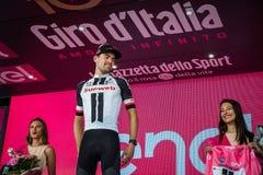 Ortisei, Itália 25 de maio de 2017: Tom Doumulin no pódio após uma fase dura do montain Imagem de Stock Royalty Free