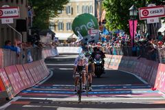 Ortisei, Italy May 25, 2017:  Professional Cyclists exhausted passes the finish line after a hard montain stage. Of Tour of Italy 2017  with an uphill finish in Royalty Free Stock Photos