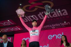 Ortisei, Italy May 25, 2017: Tom Doumulin, in pink jersey of the best rider, on the podium after a hard montain stage. Of Tour of Italy 2017 that finish in Royalty Free Stock Images