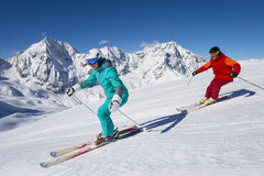 Ortles ski arena - skiing in winter wonderland. A couple by downhill skiing in winter Stock Photography