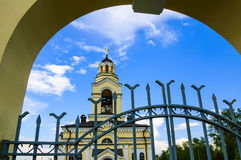 Ortodox church. On blue sky background view through the arch Royalty Free Stock Images