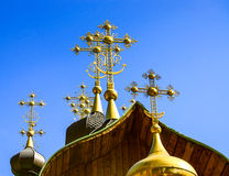 Ortodox church crosses. On blue sky background Royalty Free Stock Photo