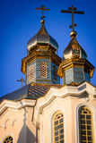 Ortodox church cupolas in the blue sky of the morning Stock Image
