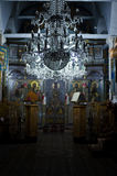 Ortodox church inside. East Ortodox church interior at the night mass in Afytos, Greece Stock Photography