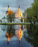 Ortodox church and its reflection in a pond. Royalty Free Stock Images