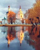 Ortodox church and its reflection in a pond. Stock Photography