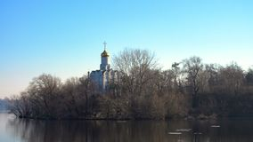 Ortodox church on a river bank at the sunny spring day stock video footage