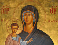 Ortodox icon. St. Mary Mother of God painted on the wall of a church in Katherine - Greece. The picture shows Mary, who in his arms, holding the infant Jesus in Royalty Free Stock Image