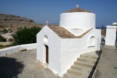 Ortodox kyrka av St Peter i den Lindos staden i den Rhodes ön Fotografering för Bildbyråer