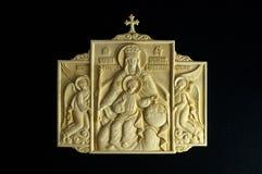 Ortodox symbol som snidas från det kolossala betet Arkivbild