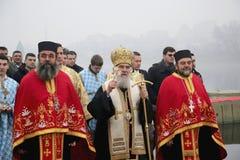 Ortodoxa kristen firar Epiphany med traditionell issimning royaltyfria foton