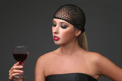 Ortrait of beautiful young woman with wine glass. Girl in retro style. Royalty Free Stock Images