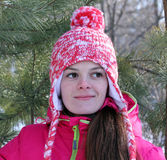 Рortrait of a girl with a red cap with a pompom Stock Photos