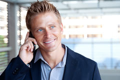 Ortrait of handsome business man using cell phone Stock Photo