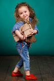 Ortrait of a little girl with books in their hands. Stock Images
