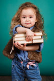 Ortrait of a little girl with books in their hands. Stock Photo