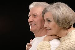 Ortrait of older couple embracing. On a black background Stock Image