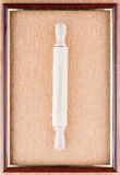 Рortrait of rolling-pin. Rolling-pin in the center of the frame on a linen background Stock Image