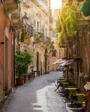 A narrow and picturesque road in Ortigia, Siracusa Syracuse, in the region of Sicily, Italy. stock images