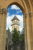 Orval Abbey, ruins and church. Editorial: Florenville, Belgium, August 6, 2016 - Orval Abbey, ruins and church seen through an arch Royalty Free Stock Image