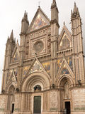 Orvieto Cathedral. The facia and portico of the cathefdral in Orvieto showing the highly decorated feezes and ornate gilt stonework stock photography