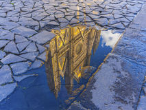 Orvieto cathedral reflection. Reflection of the Orvieto cathedral in a water puddle, Umbria, Italy Royalty Free Stock Photography
