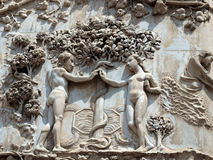 Orvieto - Duomo facade. The first pillar: scenes from Genesis.Eve offers the forbidden fruit to Adam Royalty Free Stock Photos