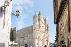 Orvieto. Italy-april 28,2018:Tourists visit the city of  and its cathedral during a sunny day Royalty Free Stock Photography