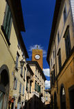 Orvieto street with Torre del Moro Stock Photos